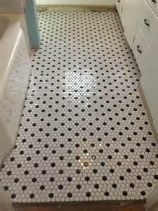 Black and white hexagonal bathroom floor tile