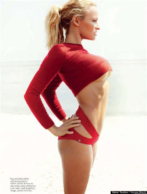 pamela anderson slips on a red for risque vogue