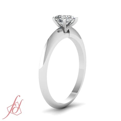 1 2 carat pear shaped knife edge solitaire