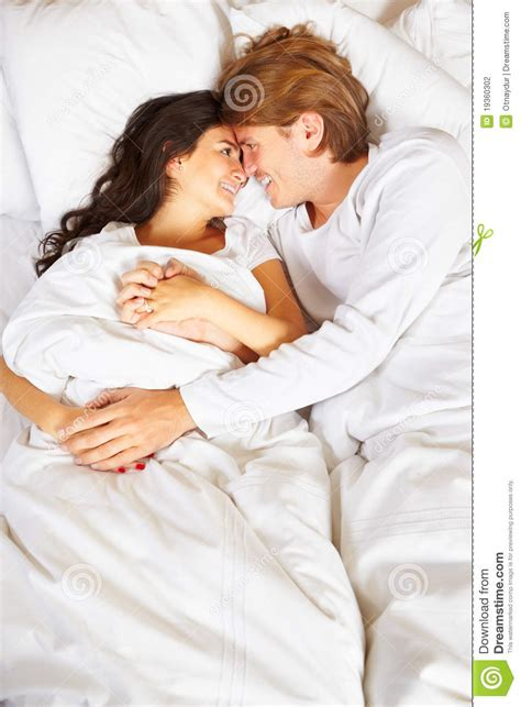 romantic pictures of couples in bed couple showing romance on bed stock photo image of adult