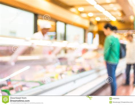 Product On Shelf by Blur Background Of Customer Select Fresh Product On