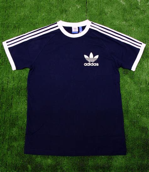 Kaos Adidas Tshirt Adidas Baju T Shirt Adidas T Shirt Adidas 3 adidas originals retro trefoil 3 stripe t shirt in midnight navy orange adidas adidas