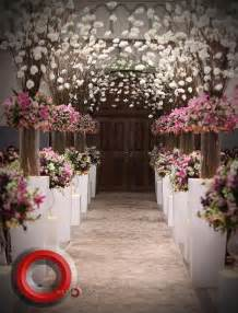 wedding aisle decorated with pink and white flowers