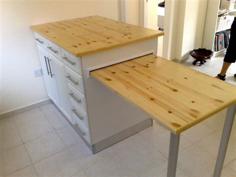 kitchen island with pull out table 27 awesome images kitchen island with pull out table