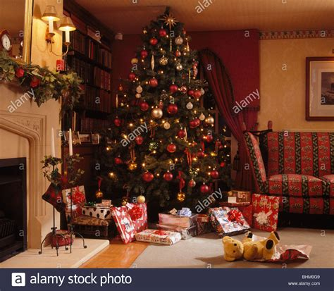 Living Room Presents Wrapped Gifts Below Decorated Tree In