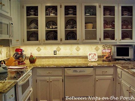 what s inside those glass front kitchen cabinets frog glass front cabinets for your kitchen