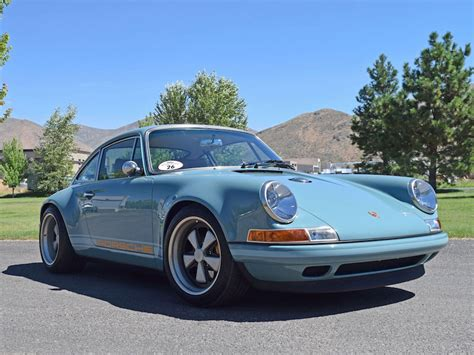 porsche singer blue driving a 500 000 singer customized porsche 911 ruins