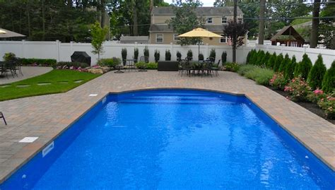 Island Pool And Patio by Poolscapes Patios Basics Landscpaing Co Inc