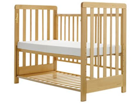 how to stop baby rolling in cot and waking up cosatto close to me bedside cot amazon co uk baby