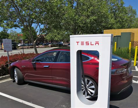 Tesla Charger Cost File Tesla Supercharging In Gilroy Jpg Wikimedia Commons