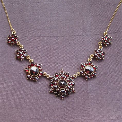 bohemian garnet necklace in gilded silver with flower