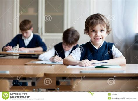 Diligent Student Sitting At Desk Classroom Stock Image Student Sitting At Desk