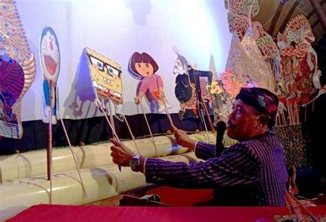 inovasi wayang kulit gambar kartun  tarik minat