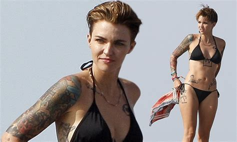 what does ruby rose neck tattoo say ruby shows tattoos in black in ibiza