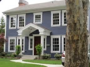 white house color exterior update blue siding white trim wood door