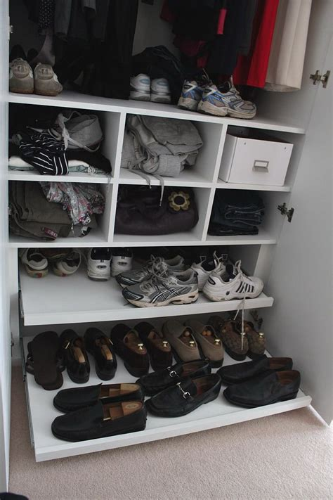 fitted wardrobe with shoe rack pull out storage and
