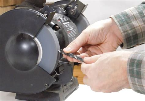 sharpening a drill bit on a bench grinder sharpening drill bits