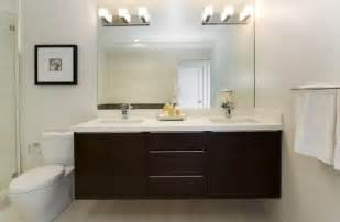 white countertop and cabinetry make this bathroom