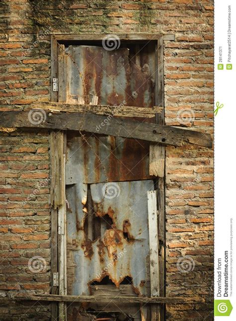 broken door   brick wall stock image image