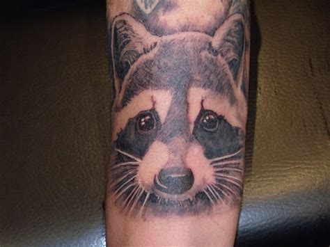 racoon tattoo raccoon arm tattoomagz