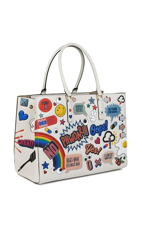 Anya Hindmarch Launches New Website by Maxi Stickered Up Featherweight Ebury By Anya Hindmarch