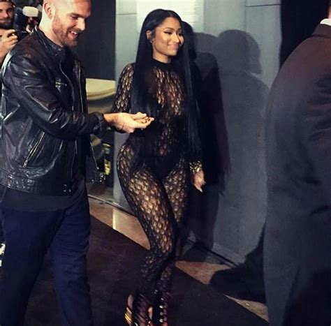 lauryn hill spouse nicki minaj steps out in sheer outfit at tidal event photos