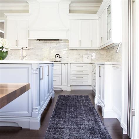white and gray kitchen with gray overdyed rug