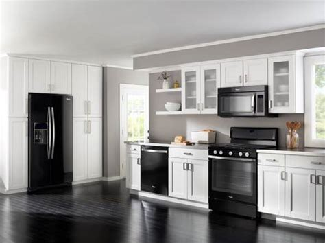 Black Kitchen Cabinets With White Appliances Kitchen With White Cabinets And Black Appliances The Interior Design Inspiration Board