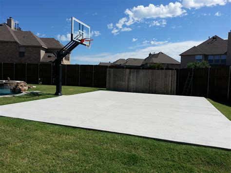 there is s concrete slab court in his backyard next
