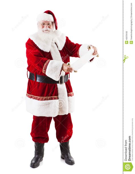 santa claus looking at the naughty and nice list stock