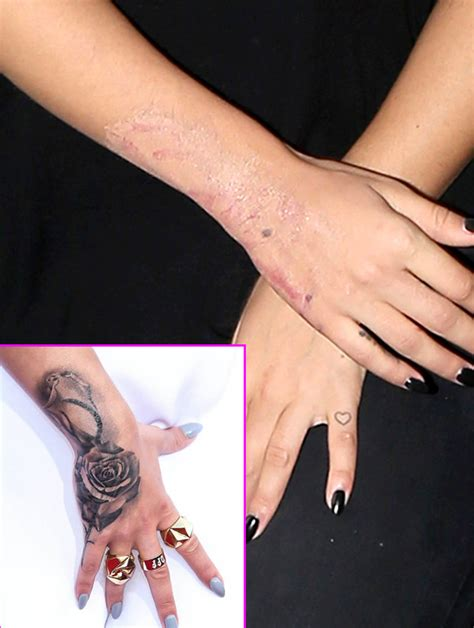 rita ora changes her mind yet again gets rose hand tattoo
