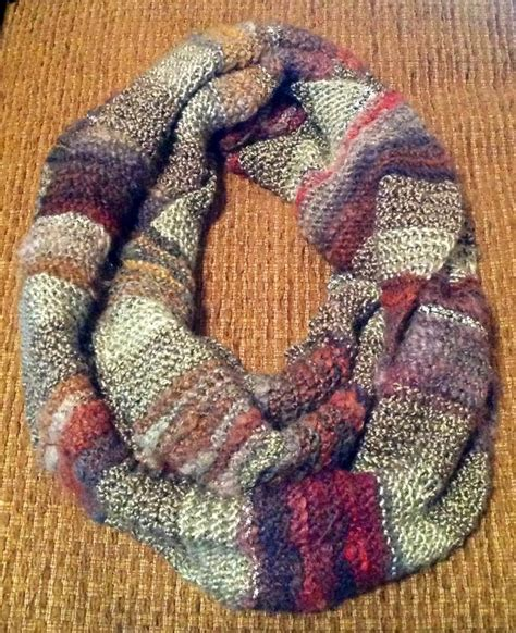 infinity scarf made with five different yarn types skeins
