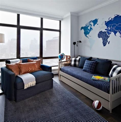 Daybed For Boys Blue And Gray Boy S Room Features A Blue World Map Mural Placed Above A Gray Spindle Daybed