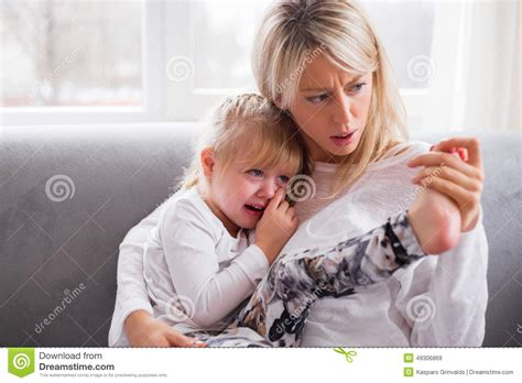 mother comforting child mother comforting her crying child stock image image