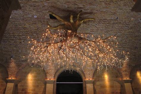 beautiful chandelier with body of dead old tree by donald