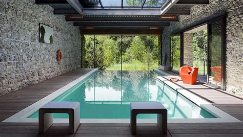 modern indoor swimming pool with glass roof home