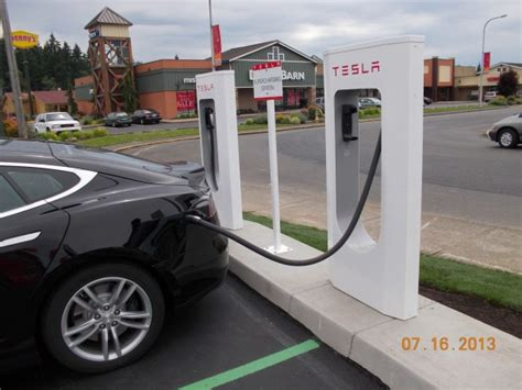 Tesla Electric Stations Tesla Unveils A Snake Like Robotic Charger That Can