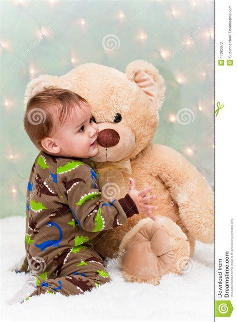 Pjhb85864 Pajamas Hug A Baby baby in pajamas holding teddy stock photos