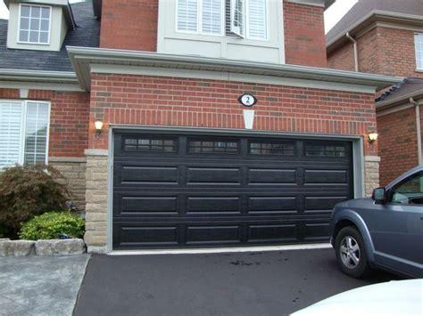 Black Garage Doors Black Garage Doors With Brick Decorating Home Ideas