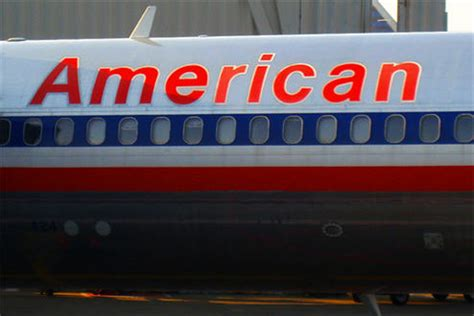 american baggage fees update american airlines agrees to waive extra bag fees
