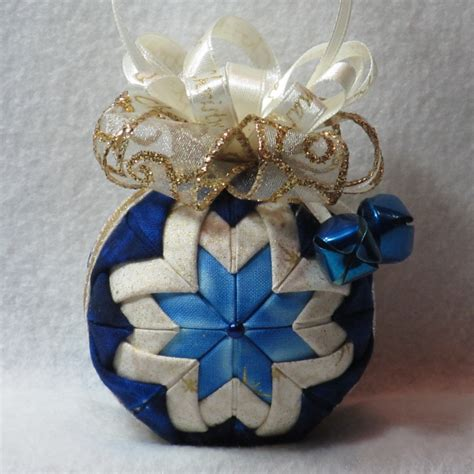 blue and gold christmas ornament quilted fabric dark and