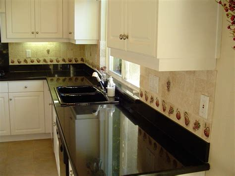 galaxy black granite counter top with white cabinets