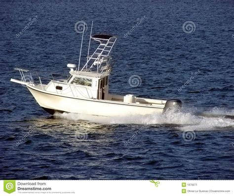 deep sea fishing in small boat small white pleasure fishing boat sailing at sea stock