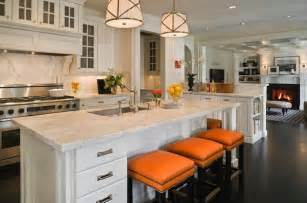 white kitchen island with stools orange bar stools transitional kitchen graciela