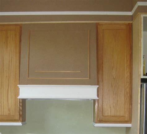 Remodelando la Casa: Adding Moldings to your Kitchen Cabinets