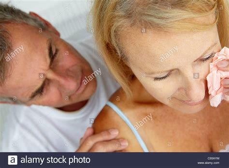 comforting crying girlfriend man comforting crying wife stock photo royalty free image