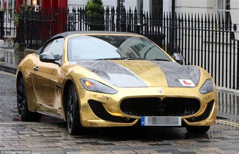 gold maserati granturismo garish pink lamborghini covered in photographs of