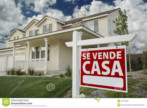 House Plans Designers se vende casa spanish real estate sign and house stock