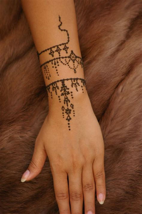hand and wrist tattoo simple henna on designs