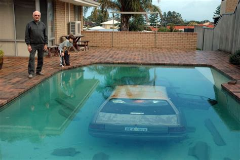 pools in backyards a car lying at the bottom of backyard pool in perth after